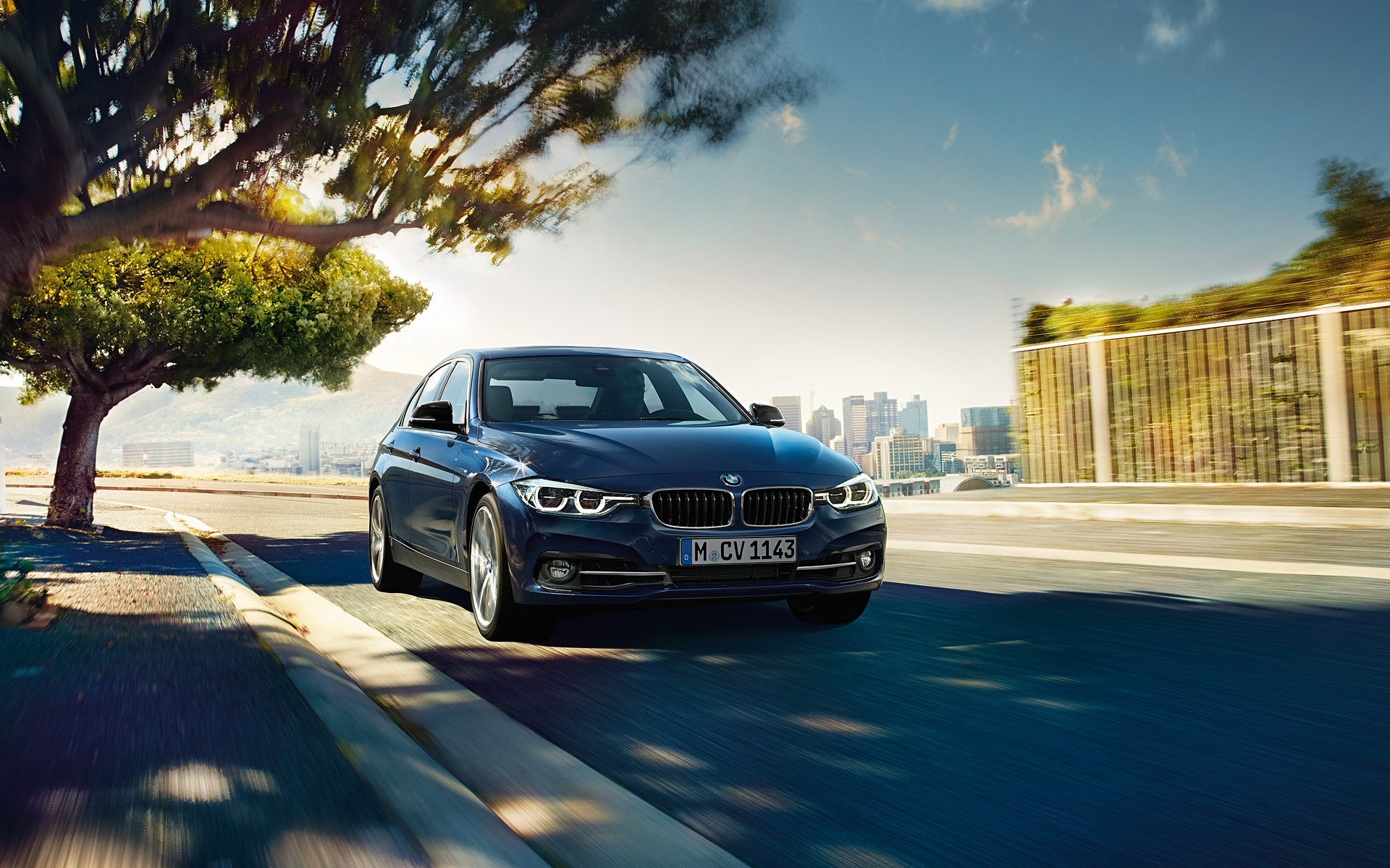 BMW 3 Series Sedan Front View city driving