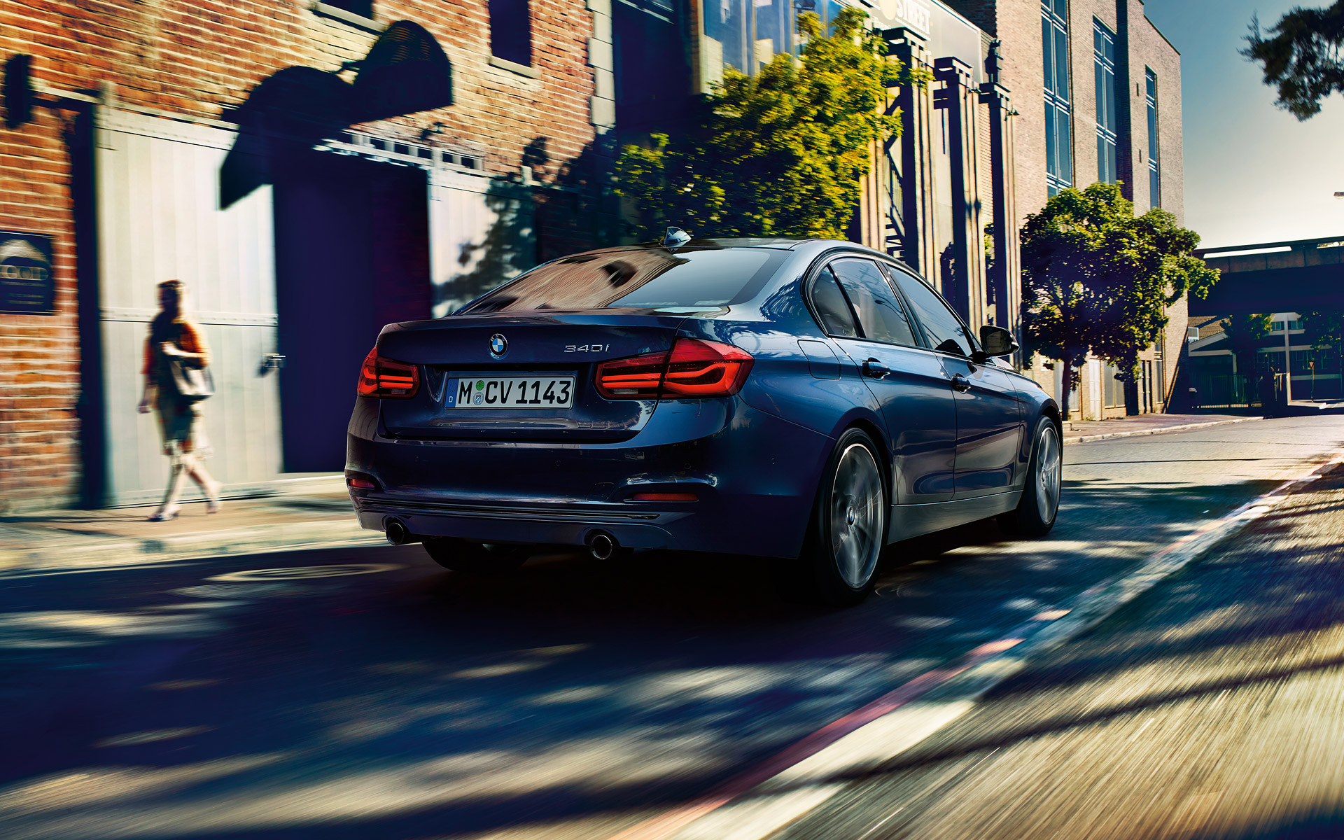 BMW 3 Series Sedan Right Rear-View city driving