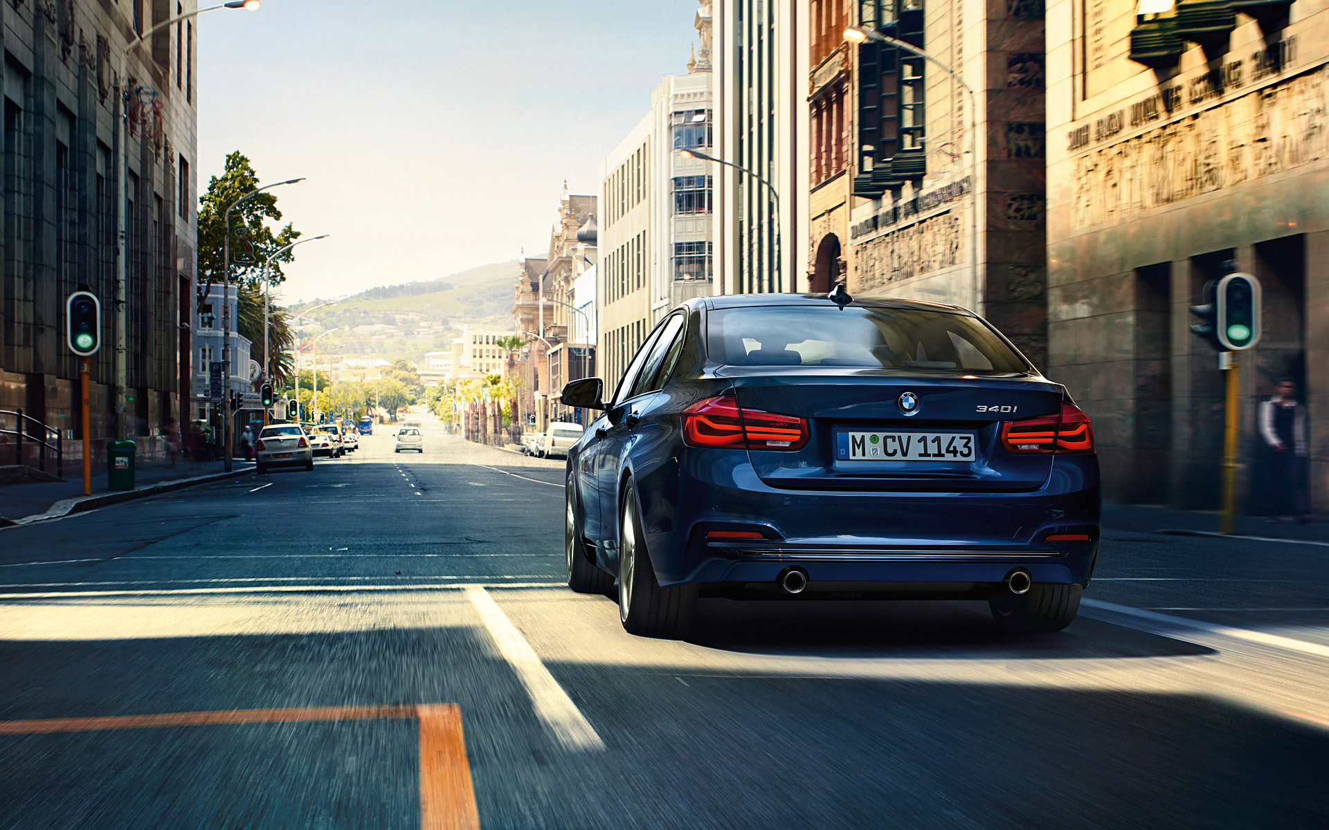 BMW 3 Series Sedan Rear View city driving