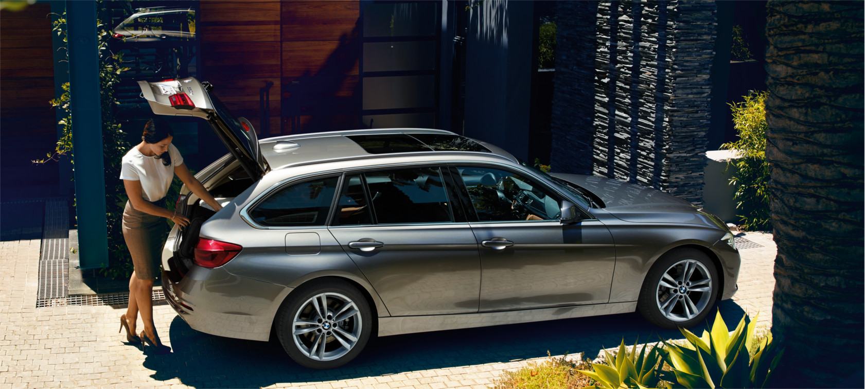 BMW 3 Series: comfortable and safe touring parked by the house.