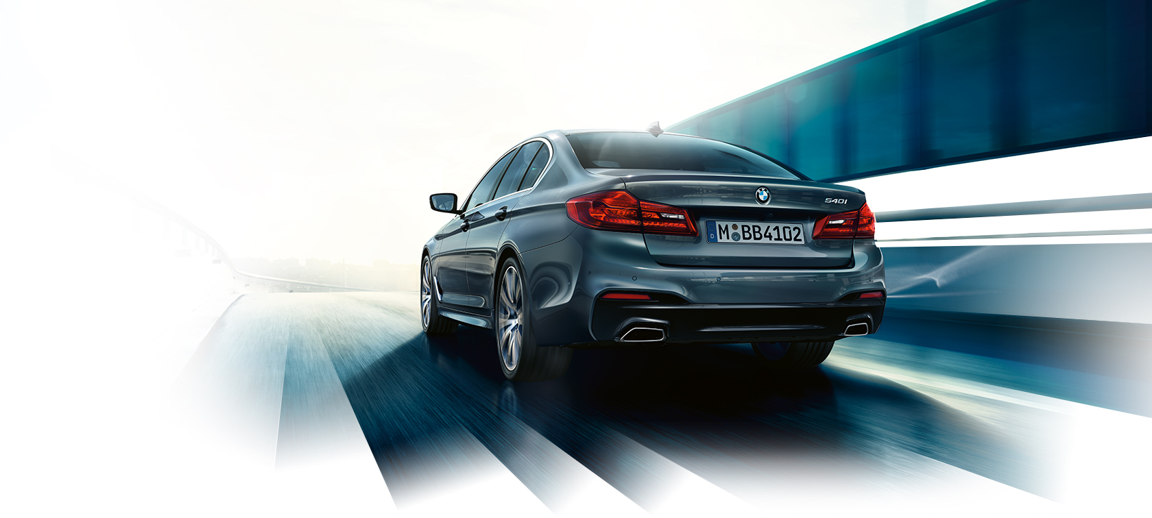 BMW 5 Series Sedan: rear view dirivng dynamics.