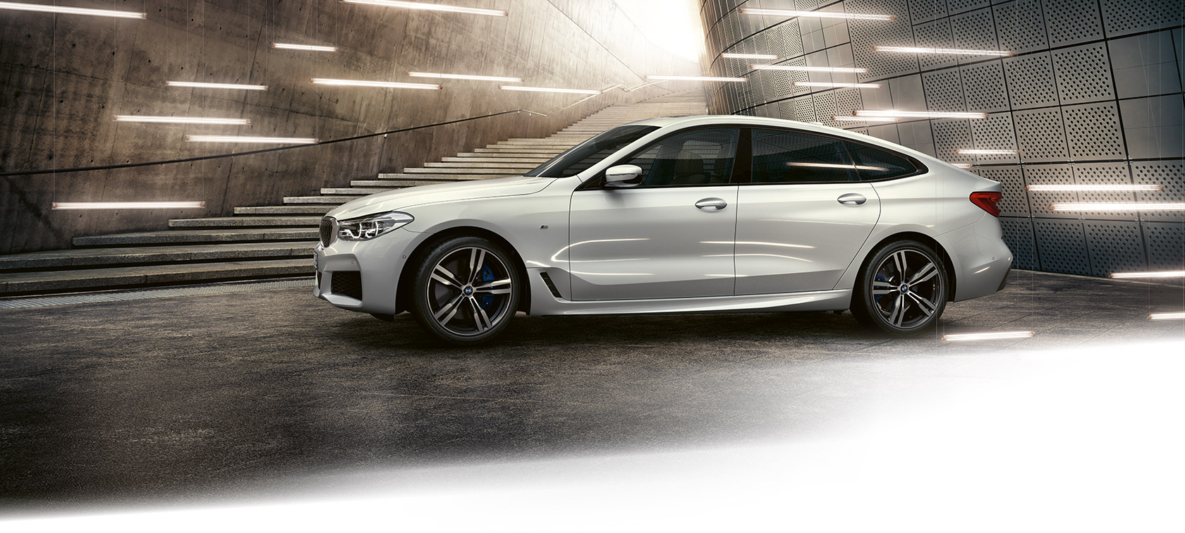 BMW 6 Series Gran Turismo: metallic car in front of steps.