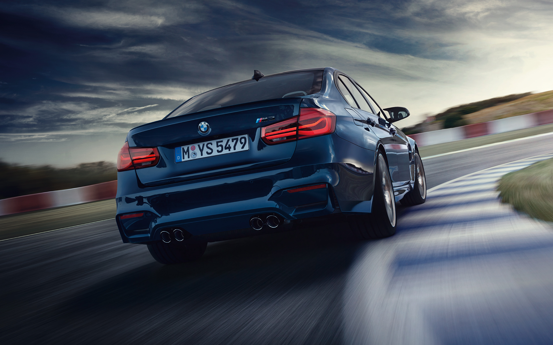 BMW M3 Sedan Rear View racetrack driving
