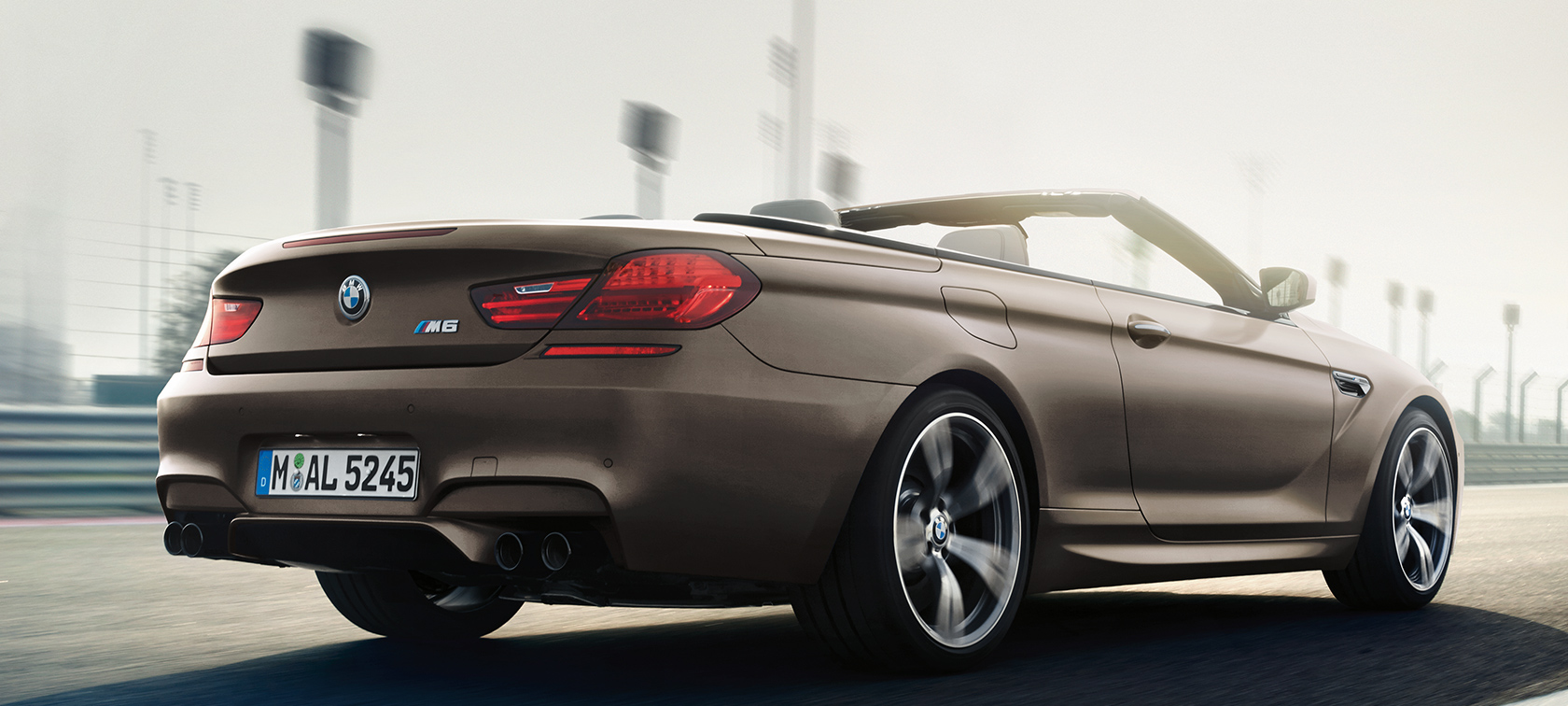 BMW M Series M6 Convertible rear three-quarter rear view in brown metallic color.
