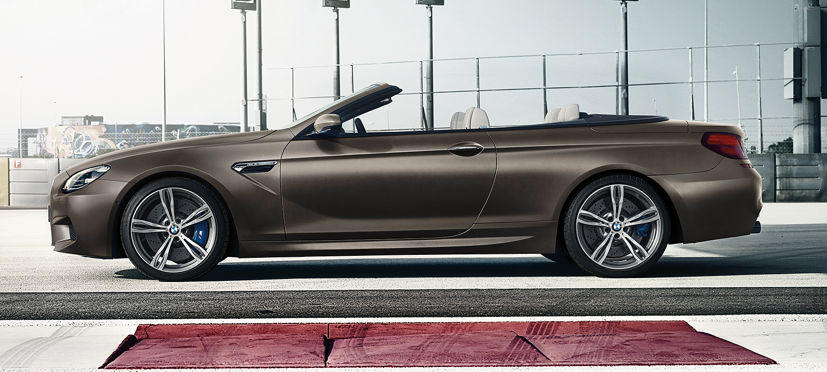 BMW M Series M6 Convertible: brown metallic color in side view.