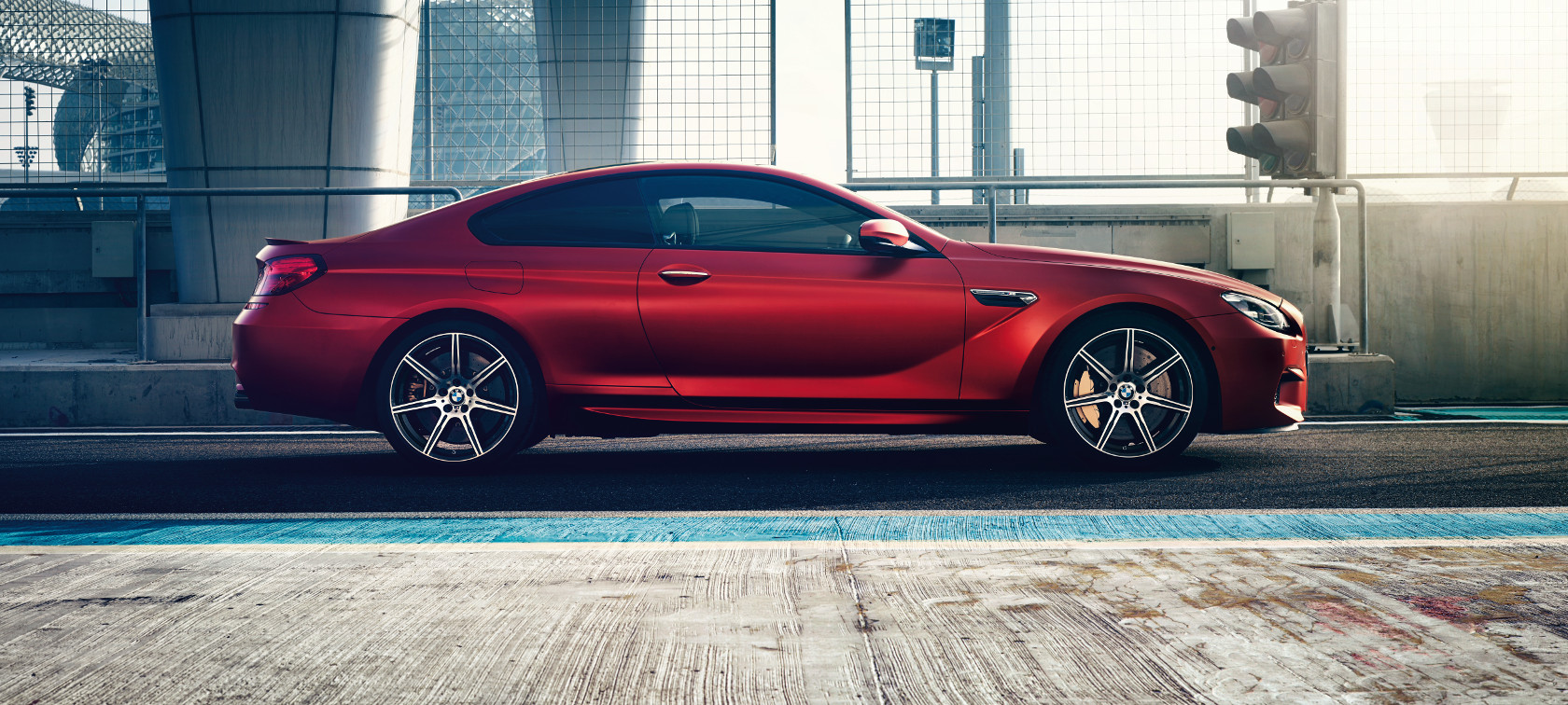 BMW M Series M6 Coupe: frozen red metallic, side view.