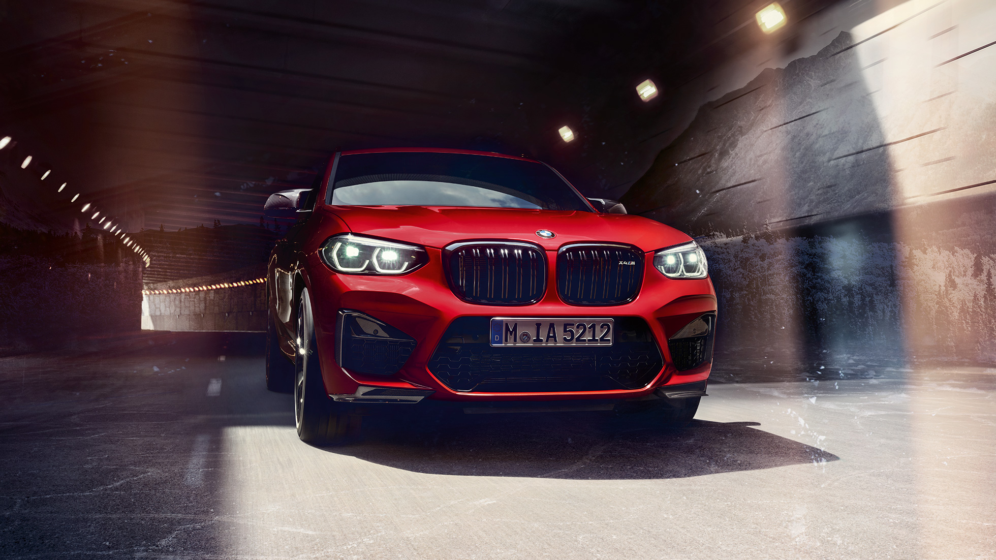BMW X4 M Competition in Toronto Red metallic, exterior, three-quarter front view.