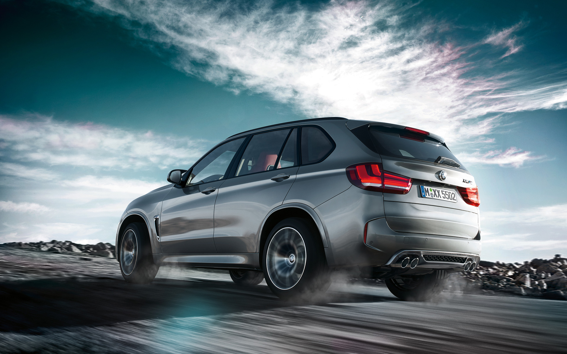 BMW X5 M Side View outdoor driving