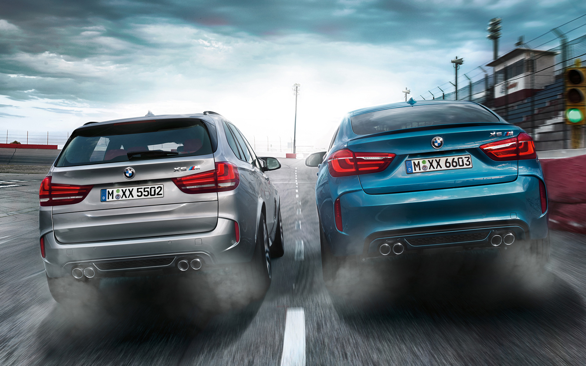 BMW X5 M and X6 M Rear View racetrack driving