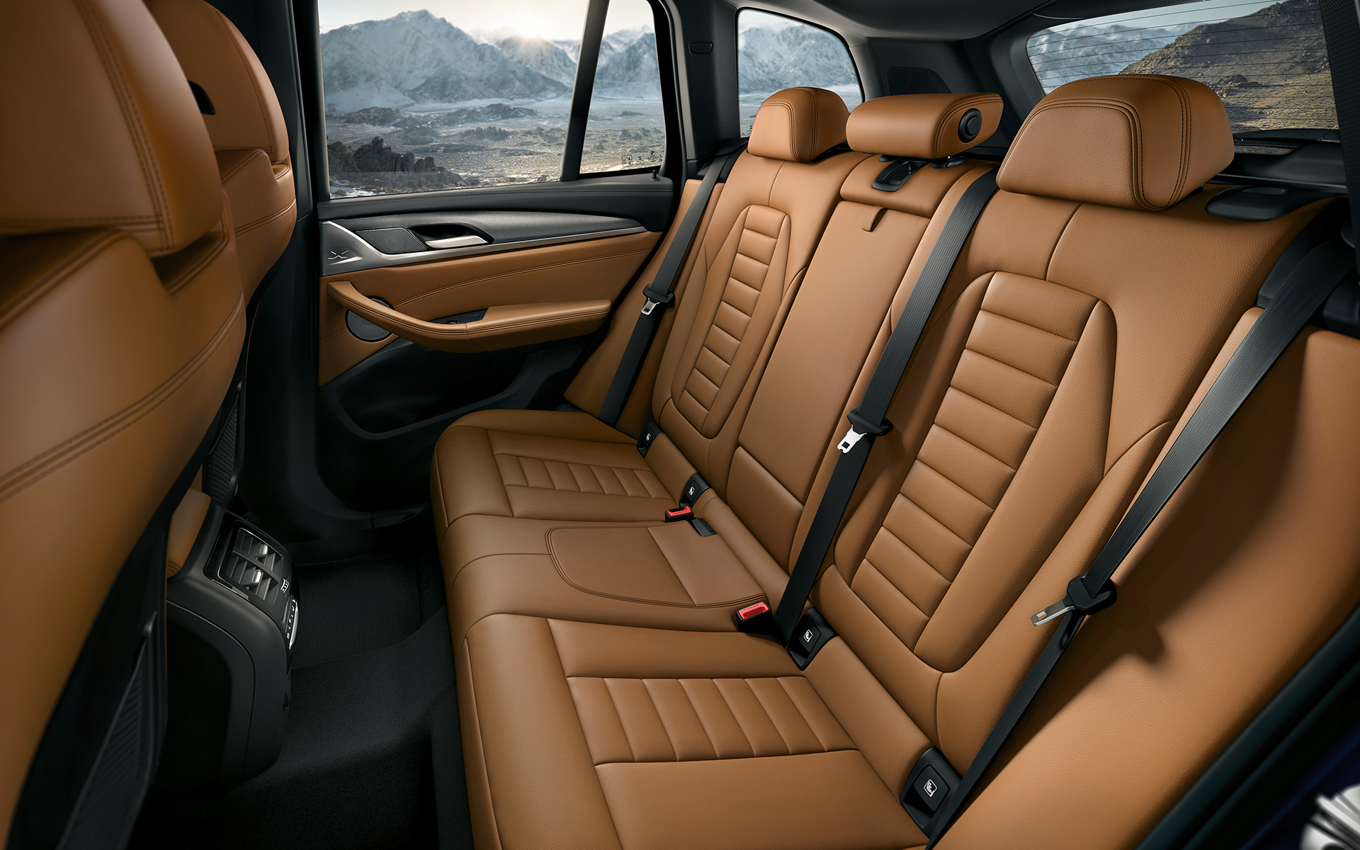 BMW X Series X3: luxurious brown leather interior upholstery design.