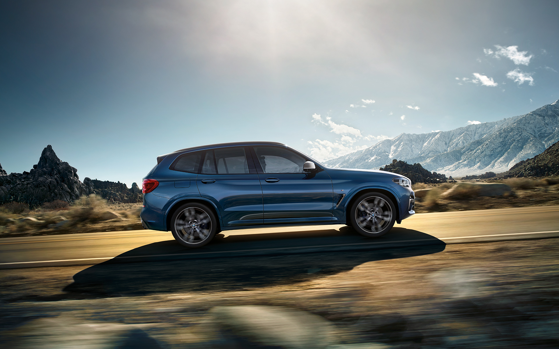 BMW X Series X3: metallic blue sunlight drive.