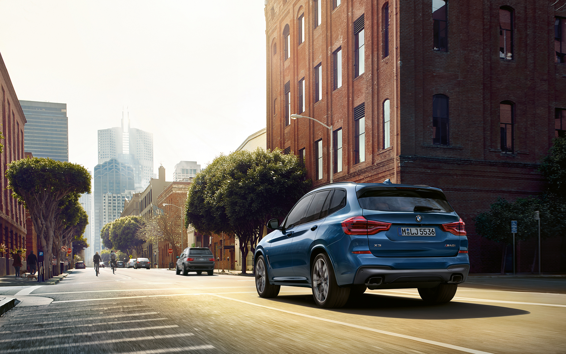BMW X Series X3: rear view during city drive.