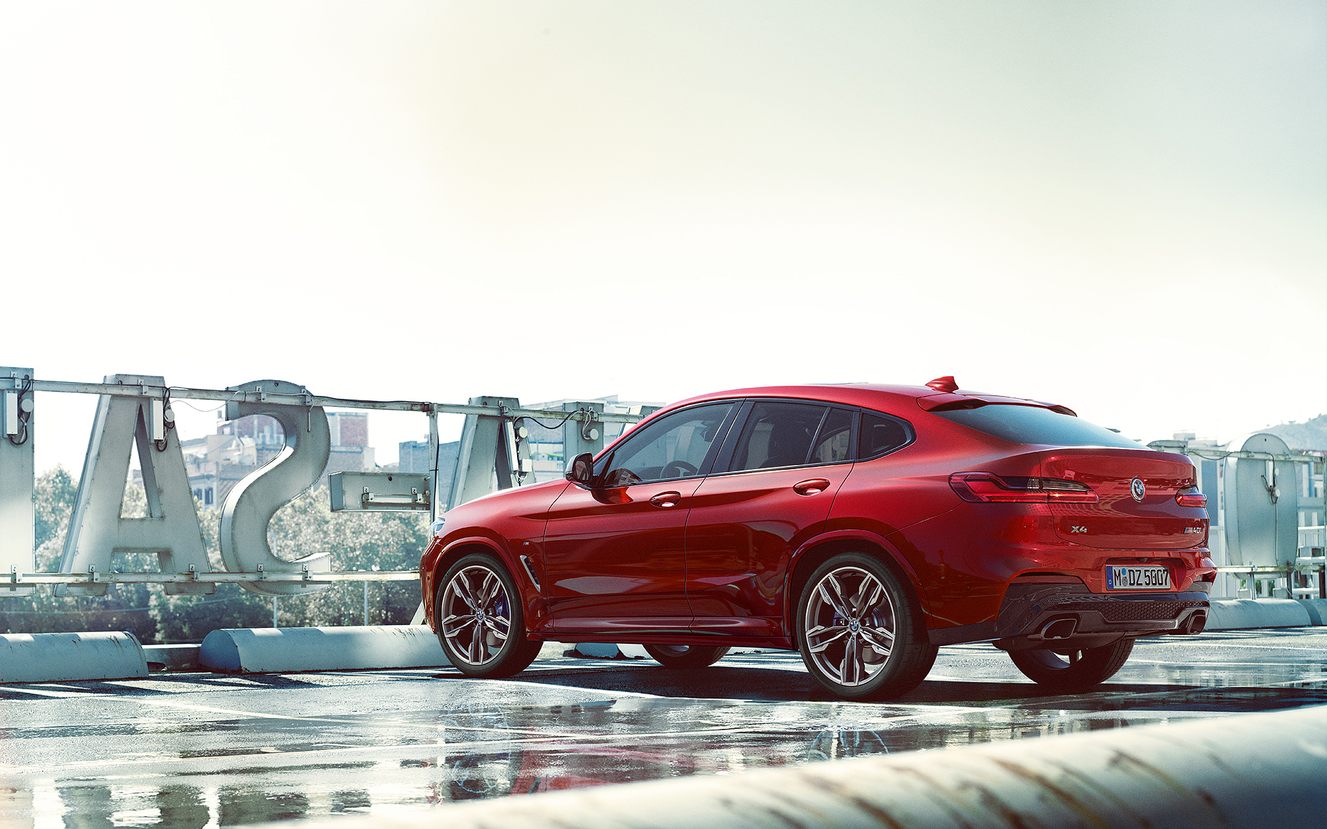 BMW X Series X4: metallic red car, carbon roof.