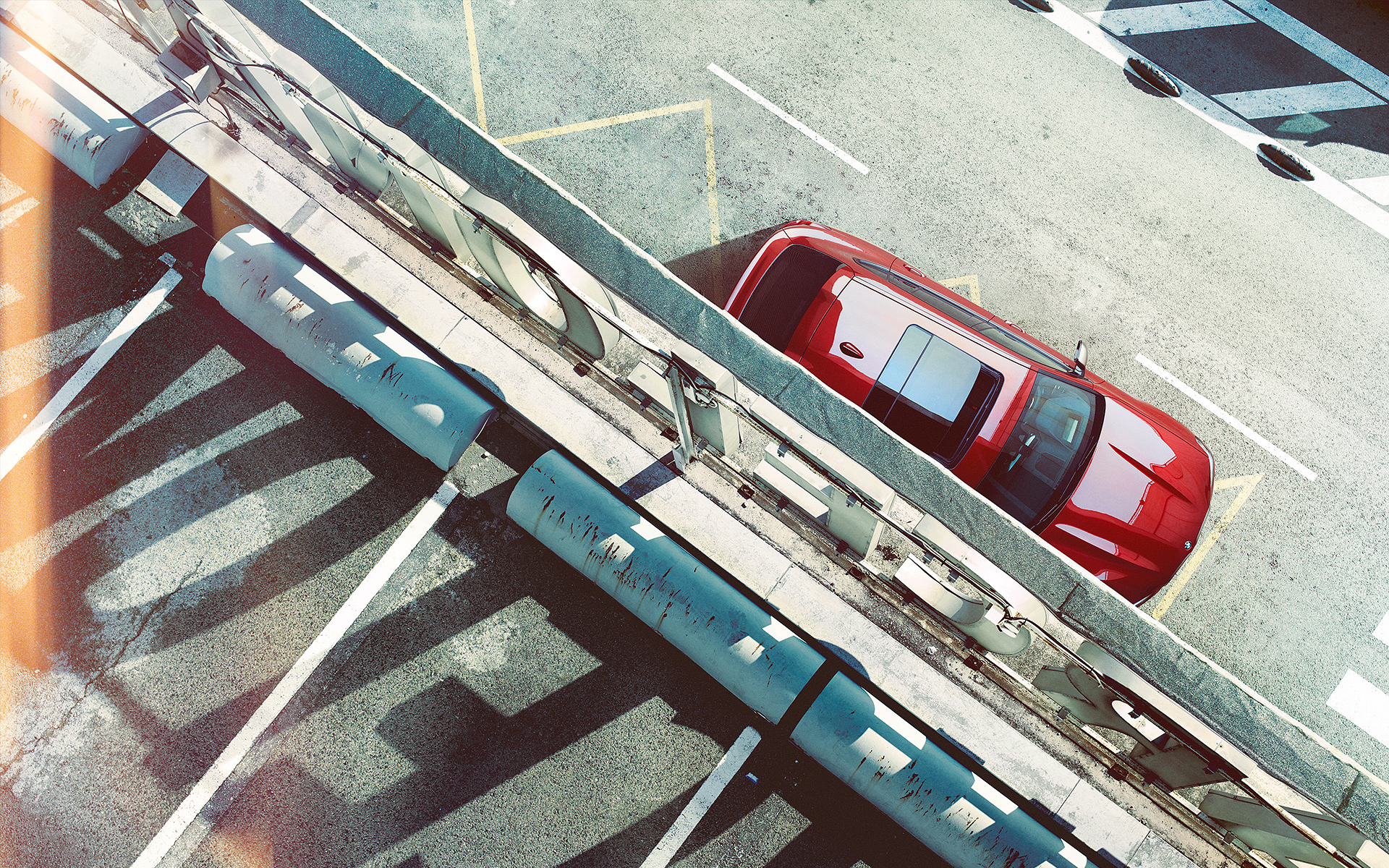 BMW X Series X4: top view of metallic red car on highway.