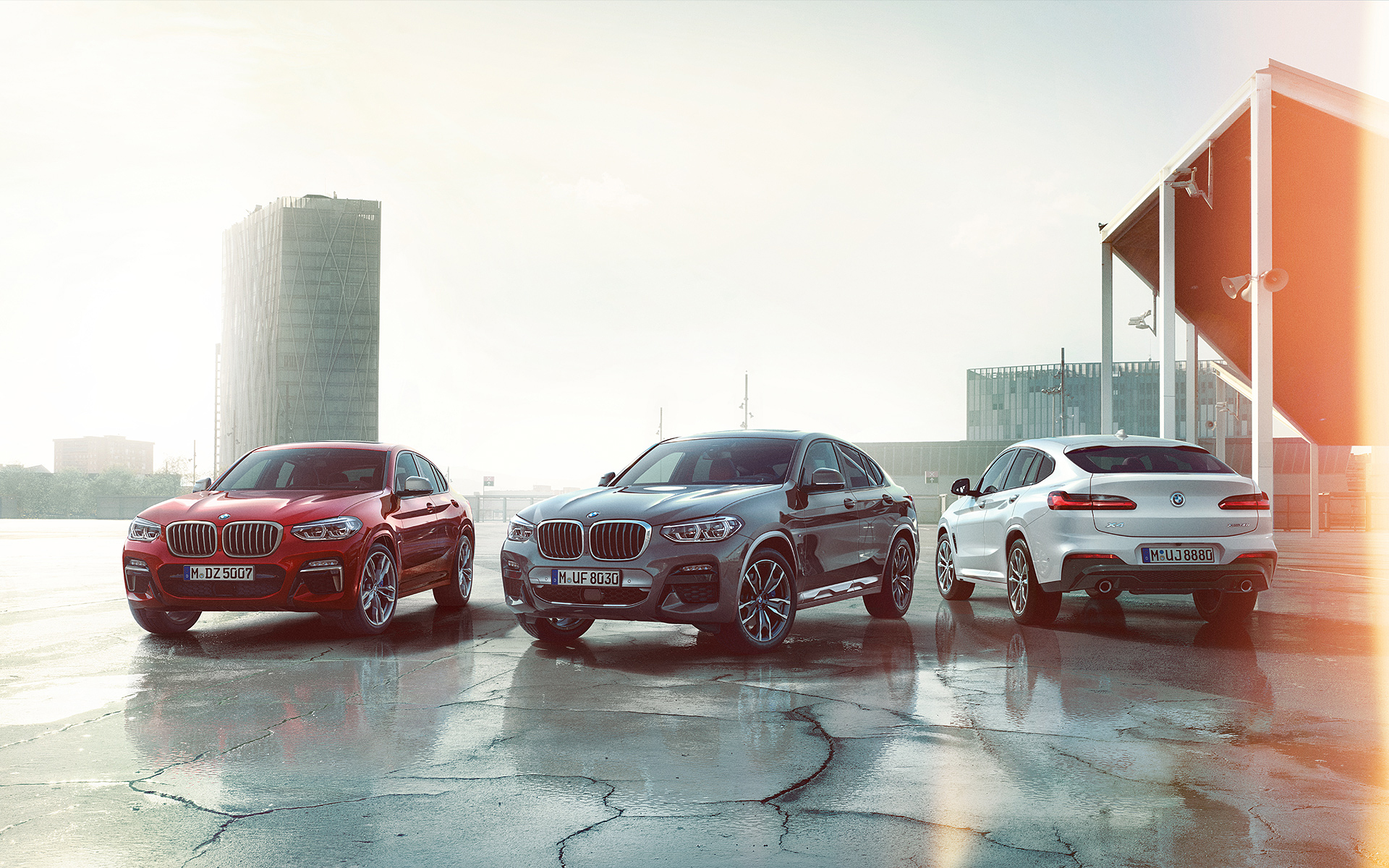 BMW X Series X4: rooftop showcase of red, grey and white metallic vehicles.