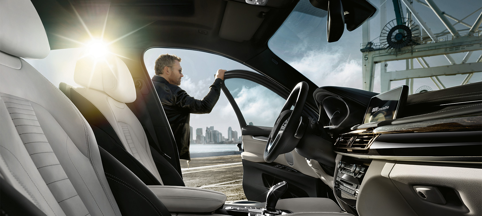 BMW X Series X6: white and black interior design with sunlight.