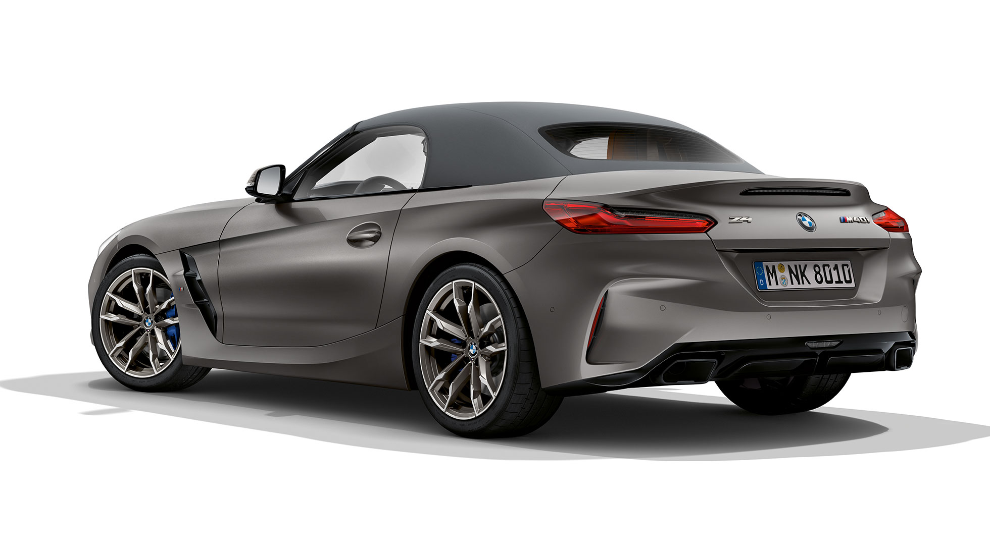 BMW Z4 Roadsteri: convertible car in three quarter rear shot.