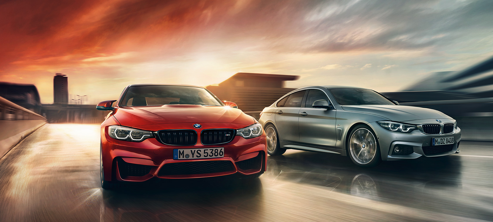 BMW 4 Series: crimson red and silver metallic grey cars racing during sunset.