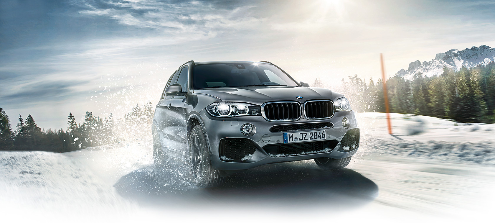 BMW xDrive racing on the snow.