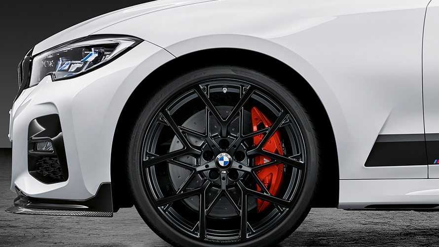 BMW original accessories: white car with black wheel disks.
