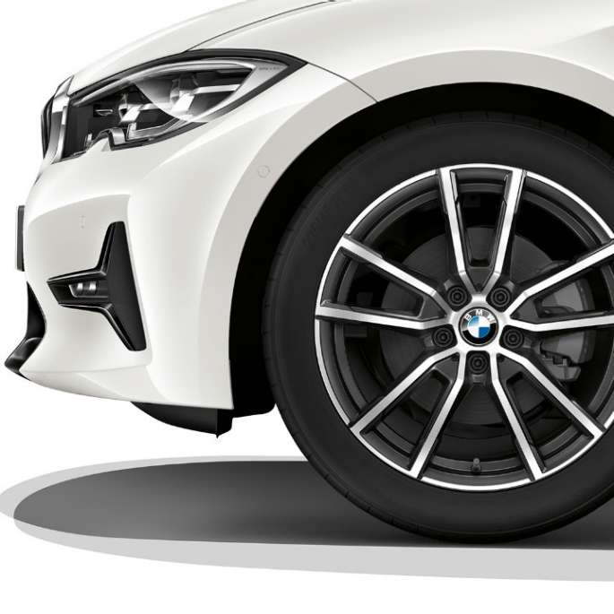 Close-up of the light alloy wheel of the BMW 3 Series Sedan with Sport Line equipment.