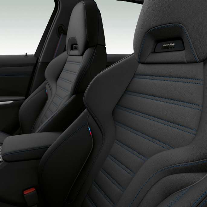 Side close-up of the front seats of the BMW 3 Series Sedan with M Sport package features.