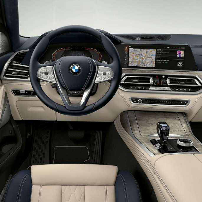 BMW X7 with Pure Excellence features in white and black colours.