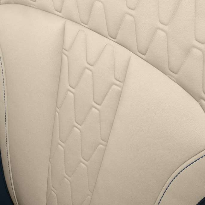 BMW X7 close-up of the car's seat design in white color.
