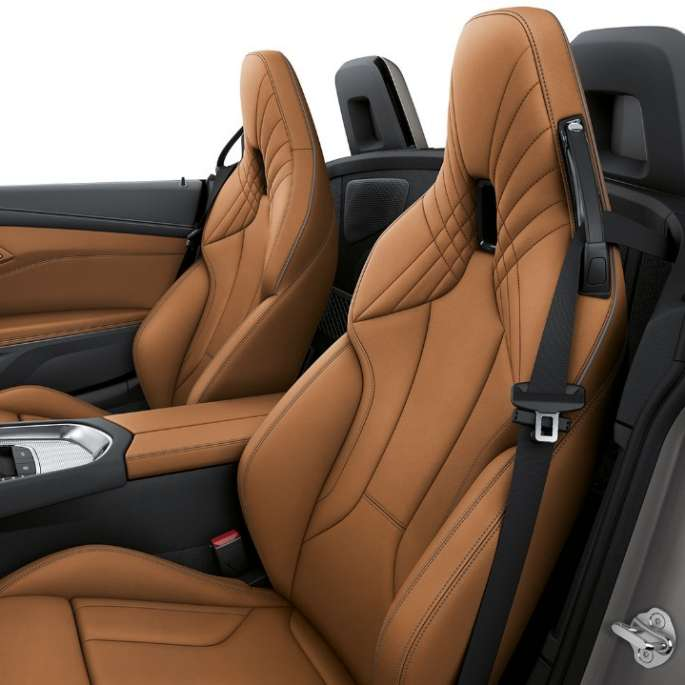 BMW Z Series Roadster: front seats with luxury leather stitching design in brown shade.
